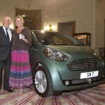 Sir Stirling Moss and Lady Moss with Aston Martin Cygnet