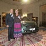 Stirling Moss presents his wife with Aston Cygnet present