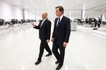 McLaren Group Chairman Ron Dennis shows UK Prime Minister David Cameron around the McLaren MP4-12C production line