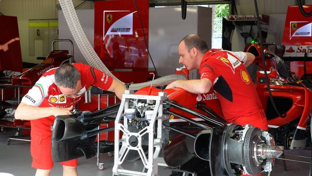 Ferrari F1 team work on the race car