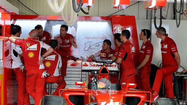 Ferrari F1 team prepare car in Monaco pit